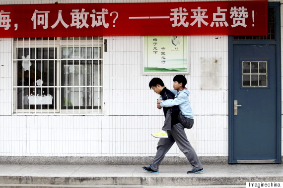 Chinese student carries disabled classmate to school every day for three years